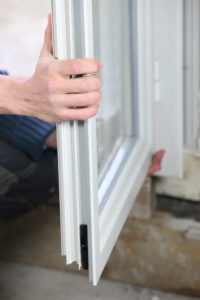 Man installing double glazed windows